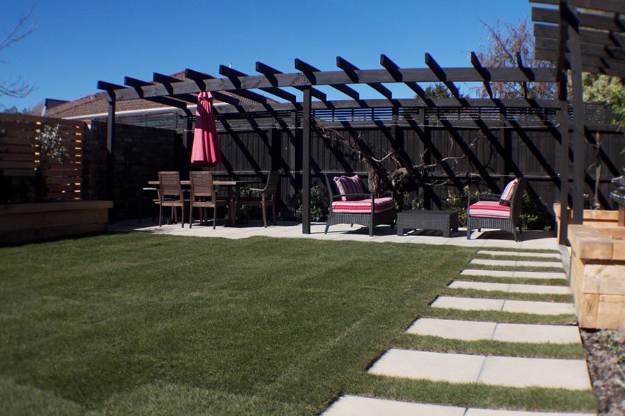 landscapes-unlimited-backyard-tiles-pergola-lawn.jpg
