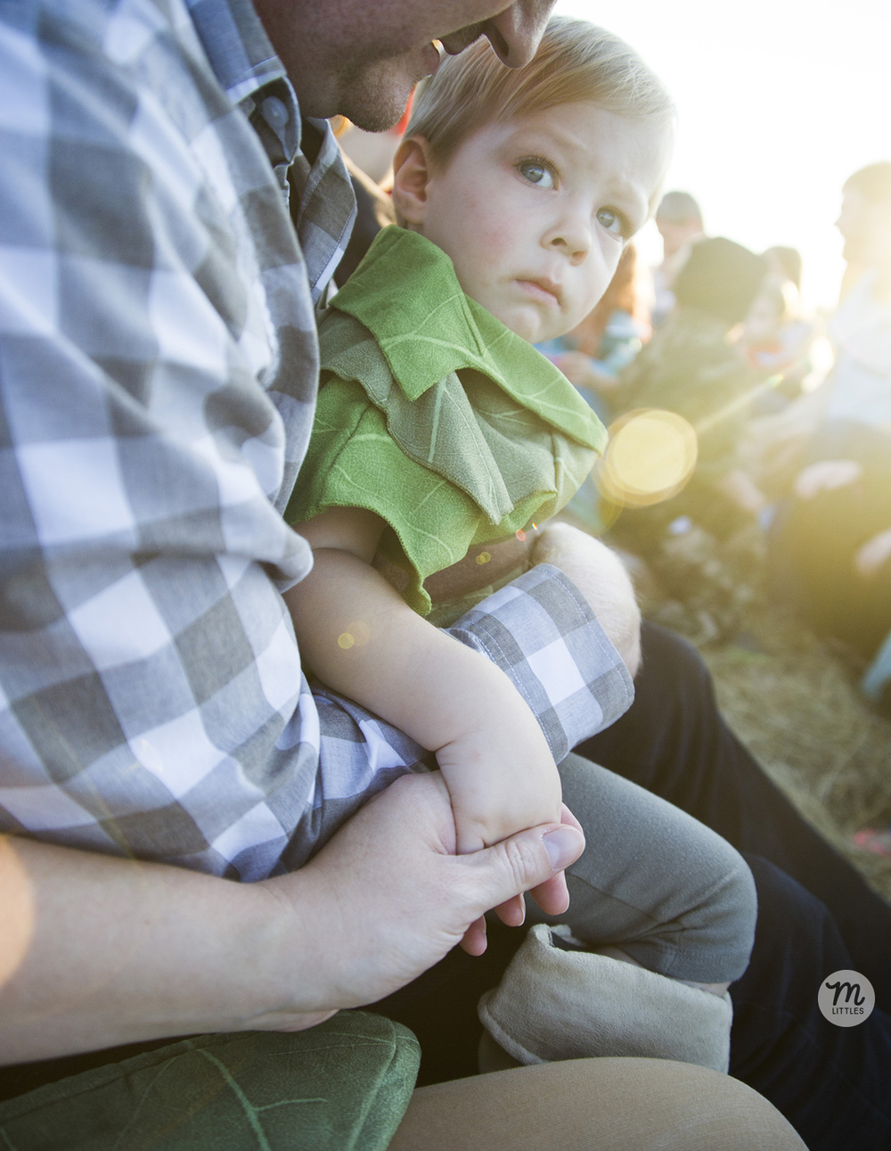 He was really nervous for the first few minutes of the hayride--having to sit in daddy's lap and hold my hand!