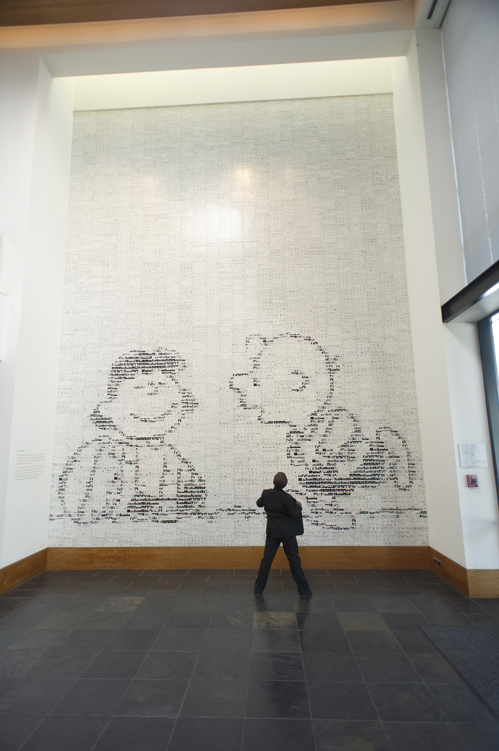 This mural is huge and amazing in person. It is made out of comic strips printed on horizontal ceramic tiles.