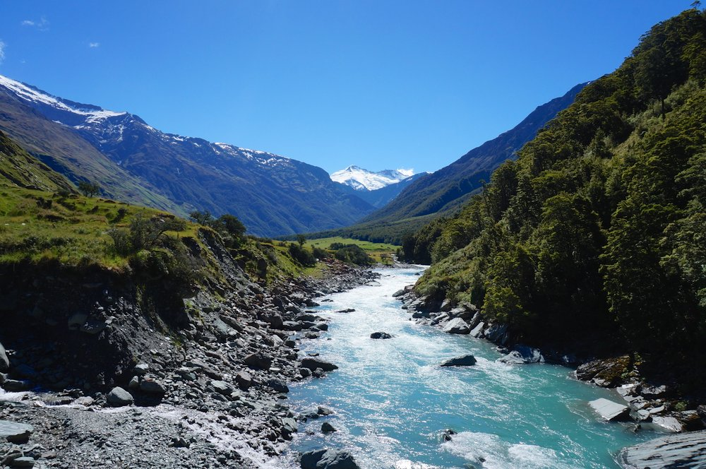 Snow-capped mountains and blazing summer heat, gushing glacial water and little white dots of sheep. If you could sum up New Zealand in one picture then this would probably be it