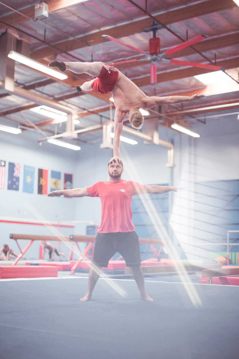 Elite performance team members, Axl Osborne and Ryan Gibson, killing skills at realis gymnastic academy redlands, june 22nd 2017. photo by Carson.Breen photography