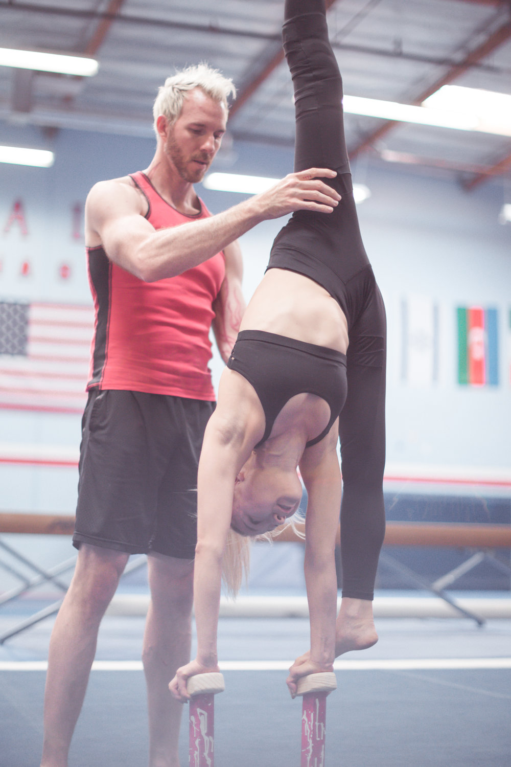 ELITE PERFORMANCE TEAM MEMBER, MARI SAITO, GETS ADJUSTED BY ACROARMY'S HEAD COACH, ARTHUR DAVIS III.
