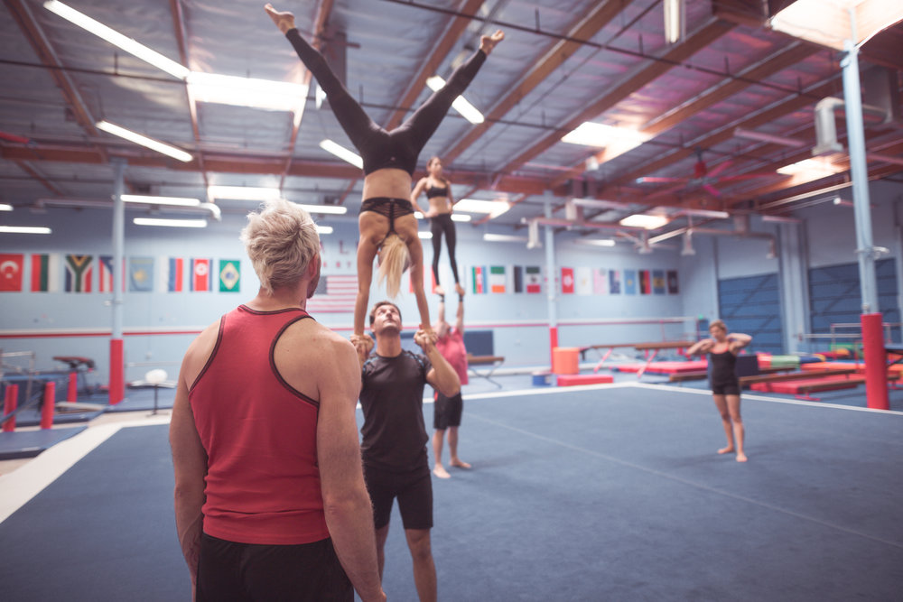 Coach arthur davis iii directs members of acroarmy's elite performance team.