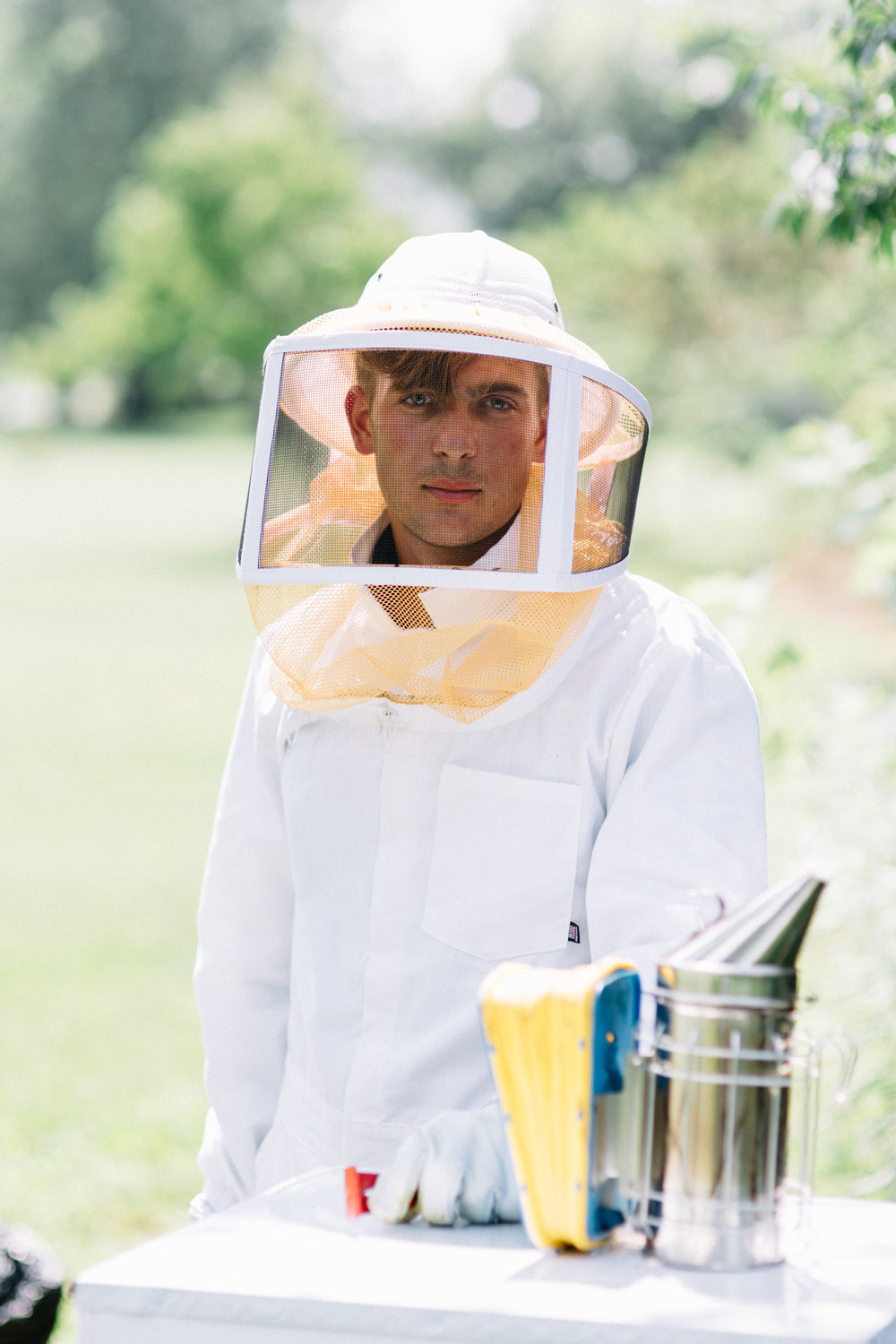Luke Hearon, 20, stands with one of two of his beehives in his yard in Olentangy, Ohio, a rural suburb of Columbus. Hearon is a beekeeper and passionate student of entomology at The Ohio State University.