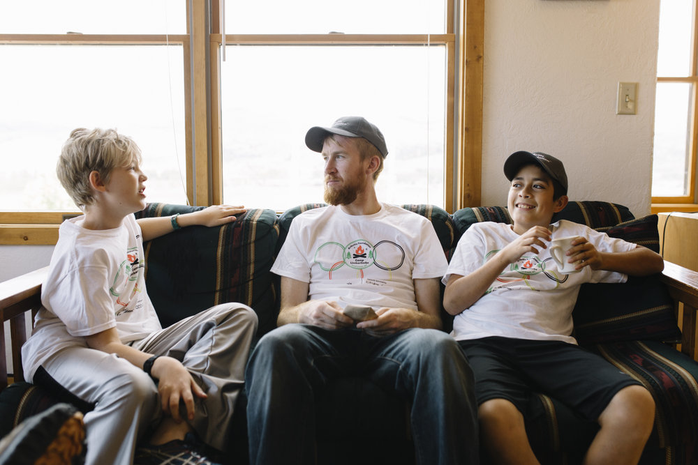 Camp Limberlimbs camper Seth Billson (left) talks with counselor Brian Christianson (center) while camper John Luke Corbett enjoys a cup of coffee before dinner at Camp Limberlimbs, a camp for children with rheumatic diseases hosted by the Arthritis Foundation, which took place at Camp Mak-A-Dream in Gold Creek, Mont. on September 23-25, 2016.