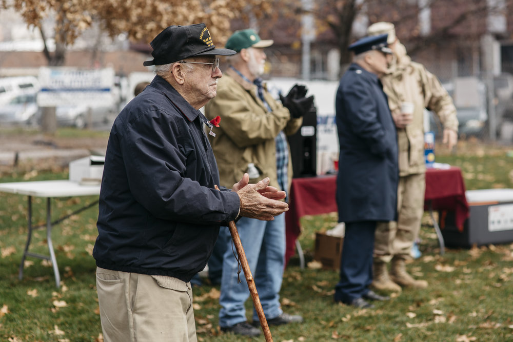 "Jerry Nelson applaudes a speaker from the back of the crowd at Missoula's Veterans Day ceremony on the front lawn of the Missoula County Courthouse on Nov. 11, 2016. Nelson was drafted into the Korean war and served in the Army's 45th Infantry Division from 1951-1953. Nelson said he returned home after the war without a scratch, feeling satisfied and like he'd done his civic duty to his country. He also raised a family after returning from war. ""I've done what every other American has done even though I'm a veteran,"" Nelson said."