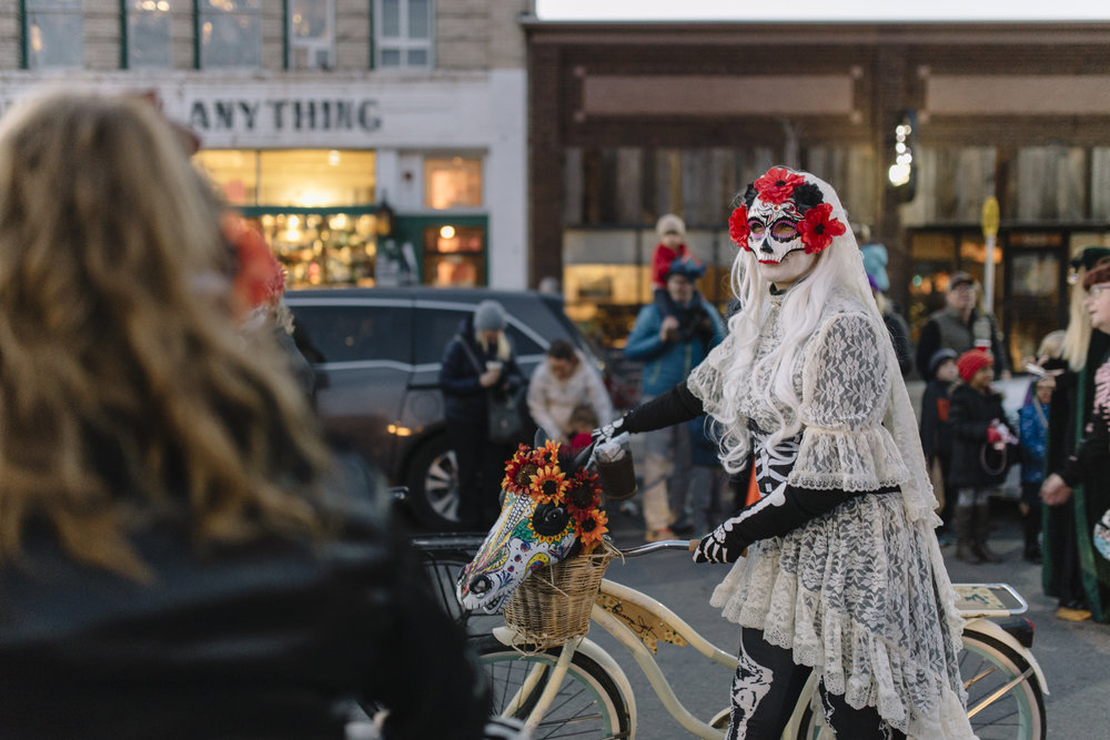 Liz Ries-Simpson marches with her bike in the Missoula Festival of the Dead parade that took place on November 2 on S. Higgins Avenue. Ries-Simpson was marching with the Montana Dirt Girls, a womens mountain biking group based out of Missoula.