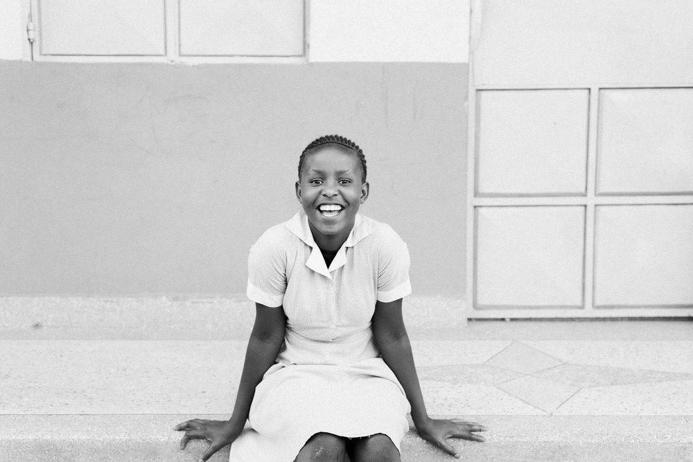 Ceinwen, my host family's daughter, sitting on the steps outside their apartment building. She taught me Swahili my first few nights in Githurai, and is incredibly inquisitive and intelligent for a twelve year old.