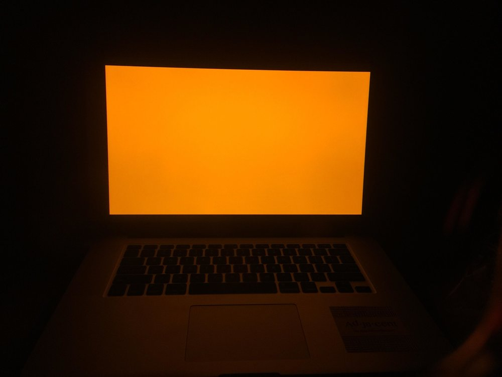 Laptop screen through UV blue light blocking glasses.