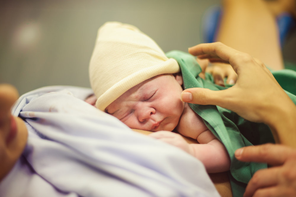 stock-photo-a-young-mother-is-breastfeeding-her-newborn-child-in-the-hospital-516261340.jpg