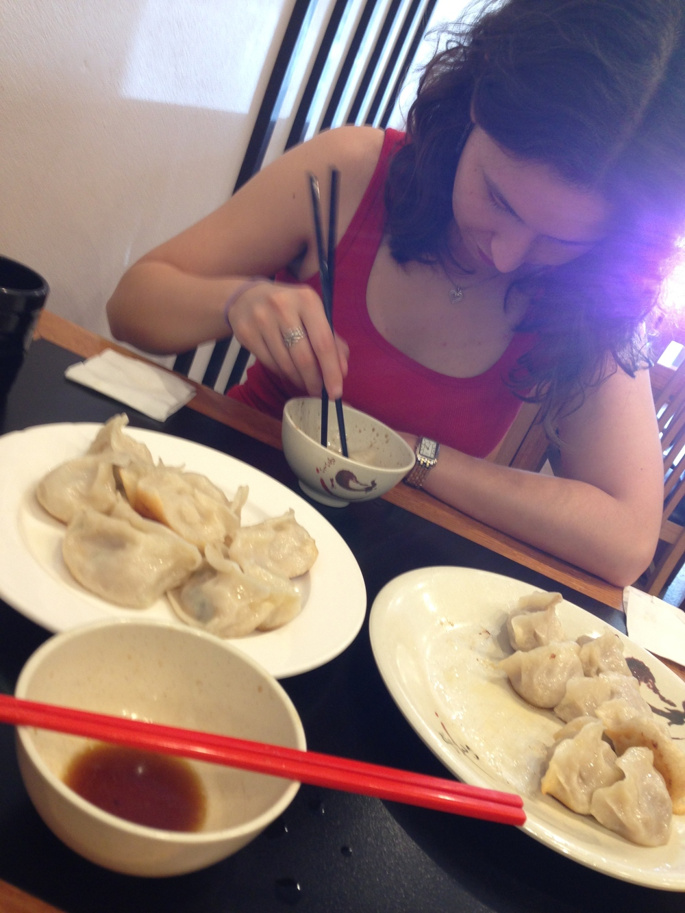Portrait of the artist with her dumplings. This is to prove that I still exist. And that I have firsthand experience with the dumplings of Australia. Photo credit: Martin Laskowski