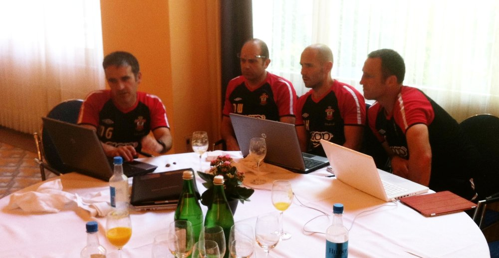 Left to right. Mo Gimpel Head of Medicine and Sport Science. Dean Wilkins 1st Team Coach. Nick Harvey 1st Team Head of Sport Science. Andy Crosby Assistant Manager.  Collaboration. Discussing the players daily morning wellness scores during Southampton's 2011 pre-season tour to Interlaken in Switzerland.