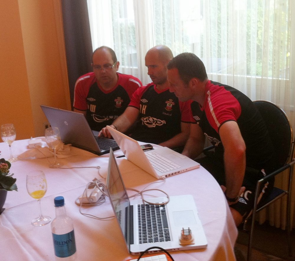 Collaboration between the Coaches in finalising the planning for the morning training session during Southampton's 2011 pre-season tour to Interlaken in Switzerland.  From the left 1st Team Coach Dean Wilkins, Head of Sport Science Nick Harvey and Assistant Manager Andy Crosby.