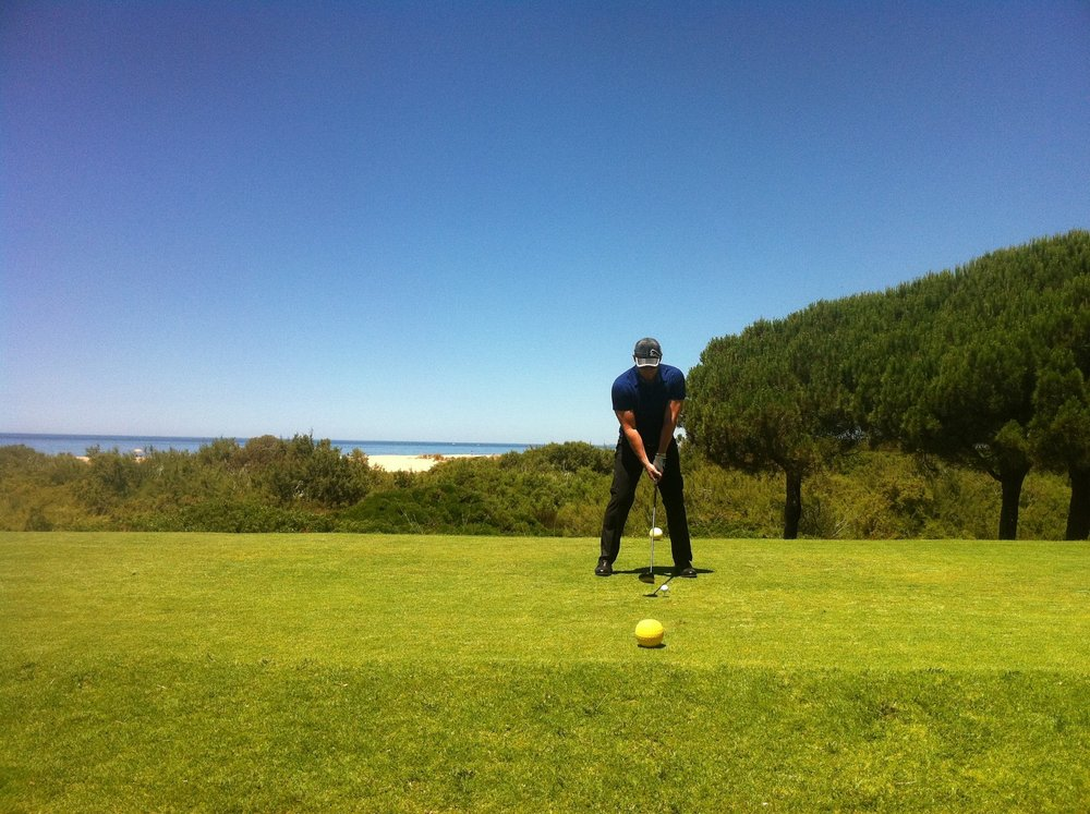 Love a game of Golf, preparing to hit the ball 'straight down the middle' in Portugal.