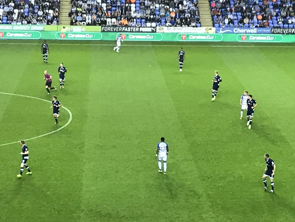 Jake Cooper playing left side centre back for Millwall v Reading in the Carabao Cup. Millwall defending with 2 banks of 4 and Reading looking to play between the lines with Gareth McCleary, No12, in space on the 1/2 turn waiting to receive the ball.