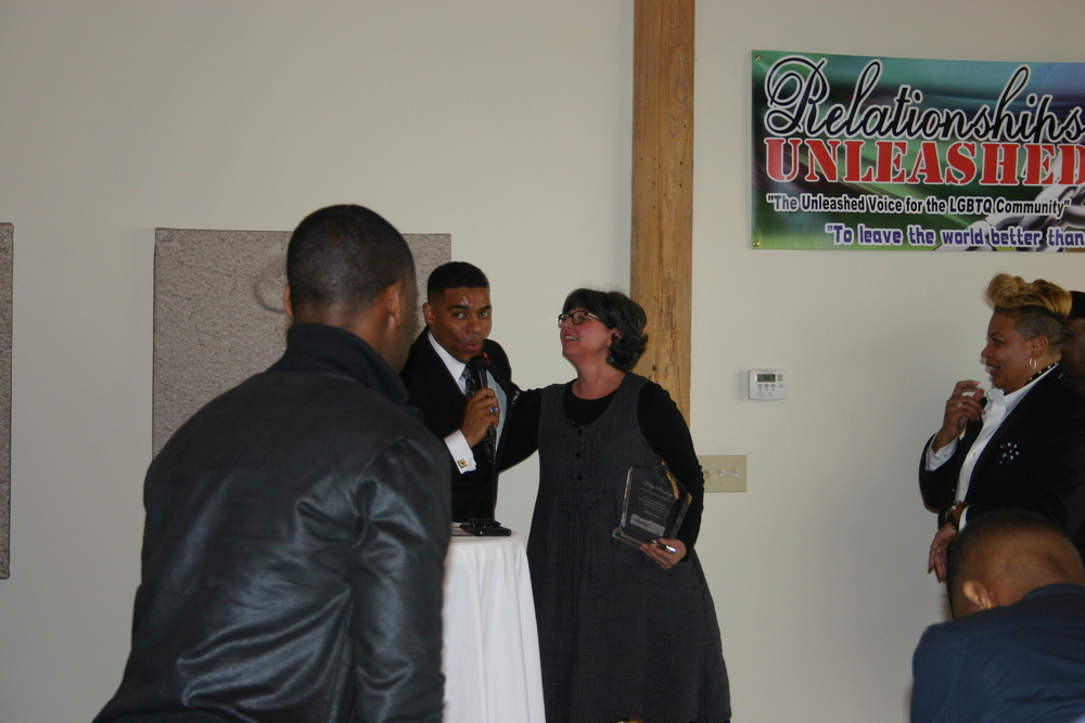 Relationship Unleashed Radio Host Davin Clemons Presents  H&M Printing Owner with an award recognizing her support for the LGBT Community