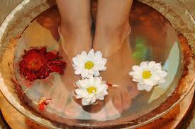 Are you suffering from dry cracked feet?   I have the remedy for you. You will need half of a lemon or lime, epsom salt, a foot bath and olive oil. Add 2 teaspoons of epsom salt into your foot bath and soak your feet for about 10 minutes or more, pat feet dry then apply lemon or lime to your toes, don't forget your cuticles and heals. Then, saturate your feet with the olive oil.  1 tablespoon per foot should be plenty then.  Put on your socks to help absorb the oil and not grease up your floors.  Leave your socks on for at least thirty minutes or more.  Great do do before a workout.  You will love your feet after you shower. The lemon or lime is great for exfoliating the skin and brightening the nail bed and the olive oil is super hydrating.  Once again inexpensive and effective!