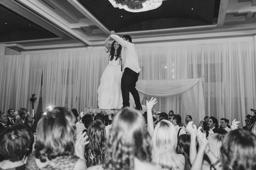 Sephardic Kehila Centre jewish wedding dance bride and groom on Table