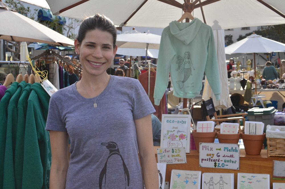 artist Brynne at the Laguna Craft Guild Art Show selling her eco-notes that grow, and screen printed apparel.