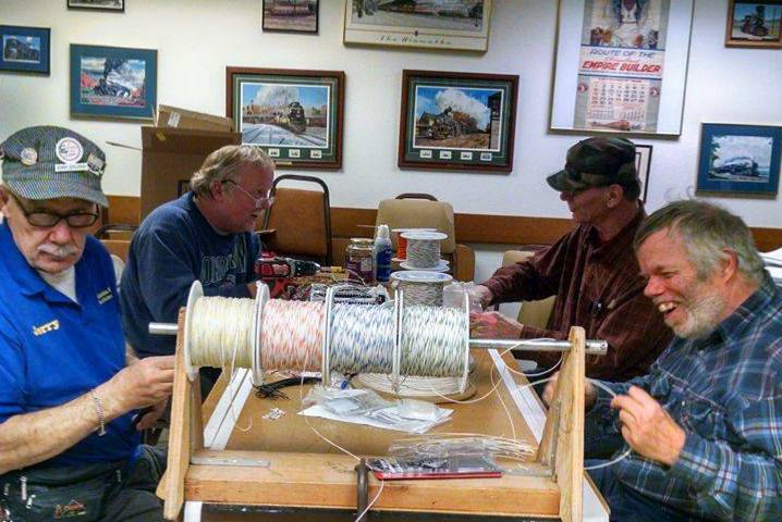 All hands on deck! CGMRC members twist wire during our last work session.