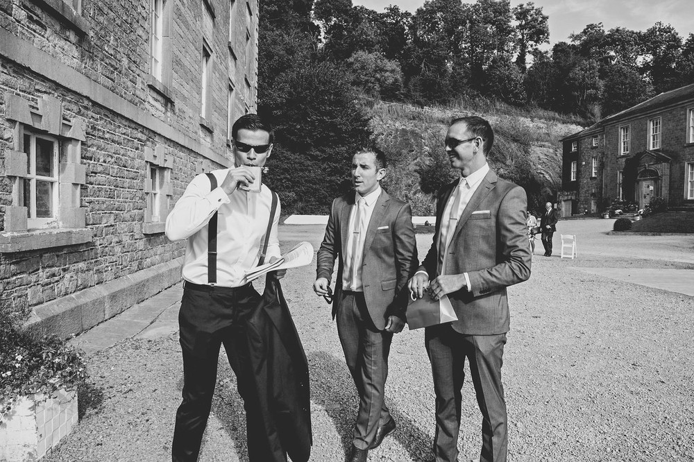 The Millhouse, Slane wedding 2014, Groom having a drink from hip flask