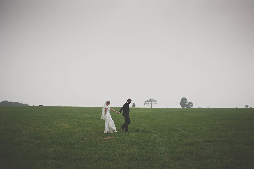Borris House wedding couple walk through field