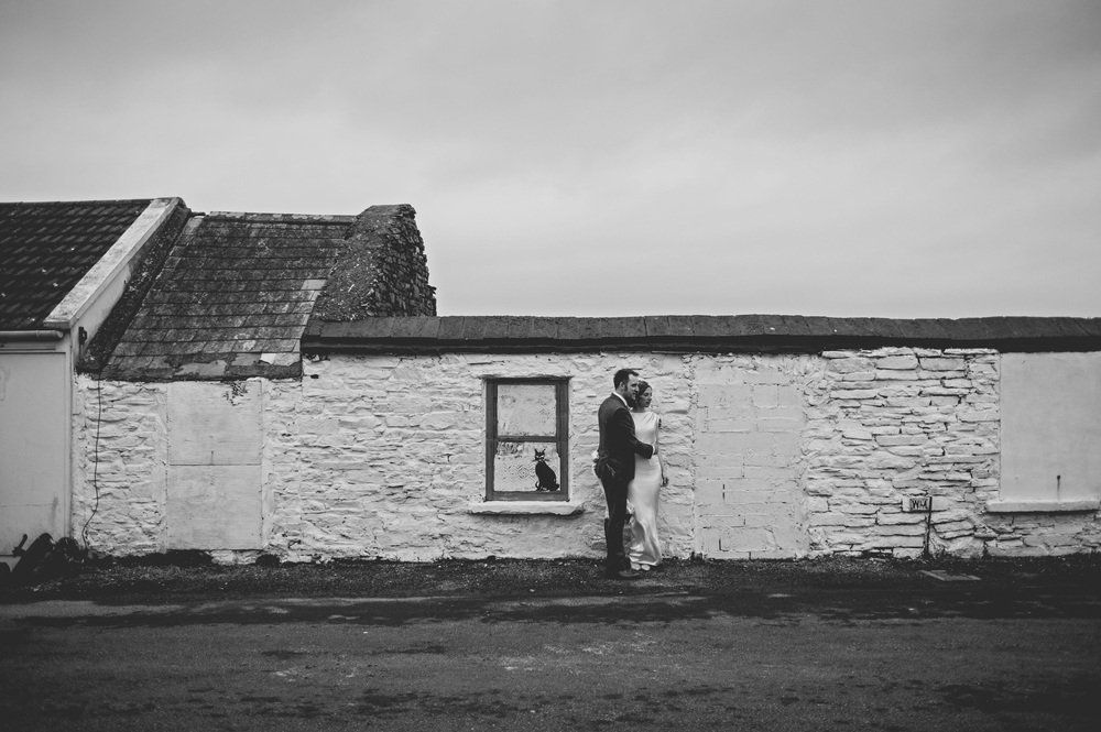 Wedding couple at old cottage