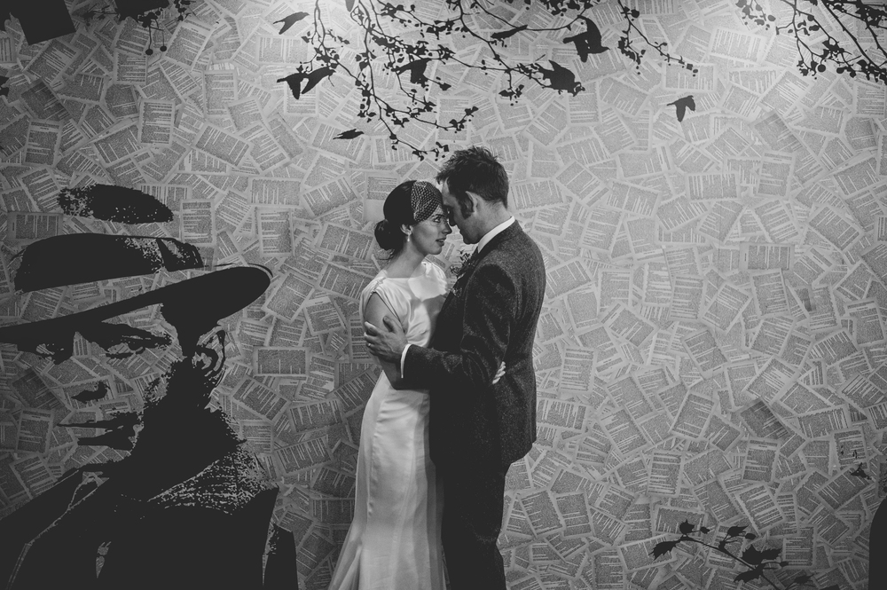 Wedding couple at graffiti wall