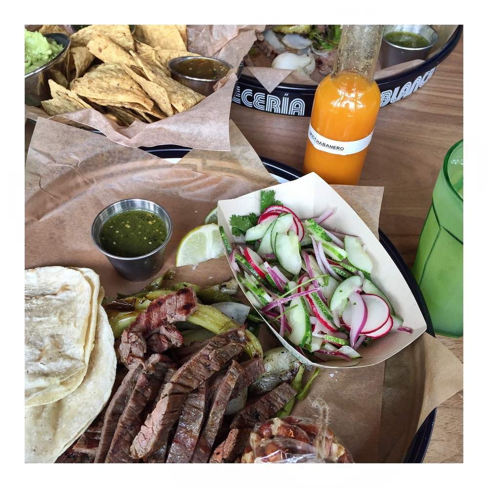 Beef tasajo taco plate, guacamole, cucumber salad, agua del dia and oaxacan peanuts.