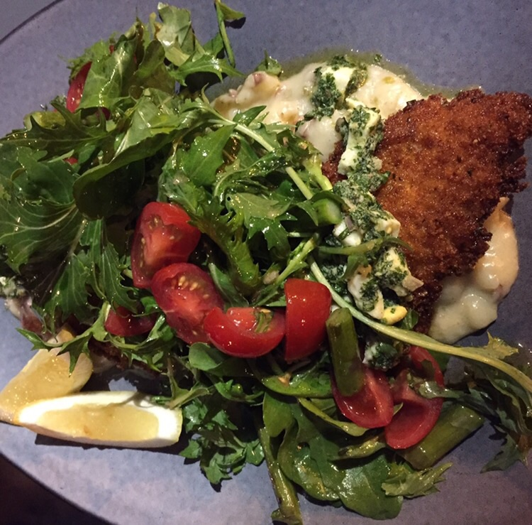 SKATE WING SCHNITZEL caper salsa verde, asparagus, arugula, watercress, cherry tomatoes, parsley new potatoes