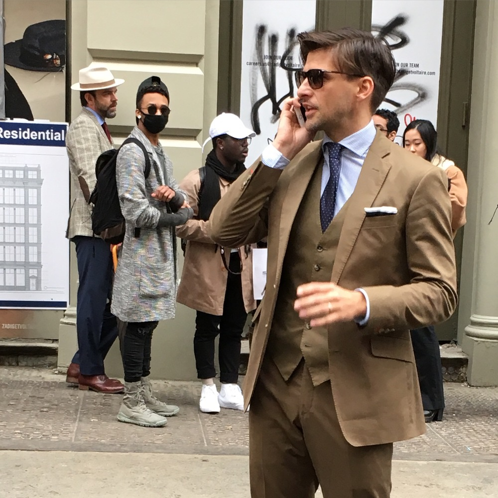 Johannes Huebl outside Suit Supply Fall/Winter 2016.