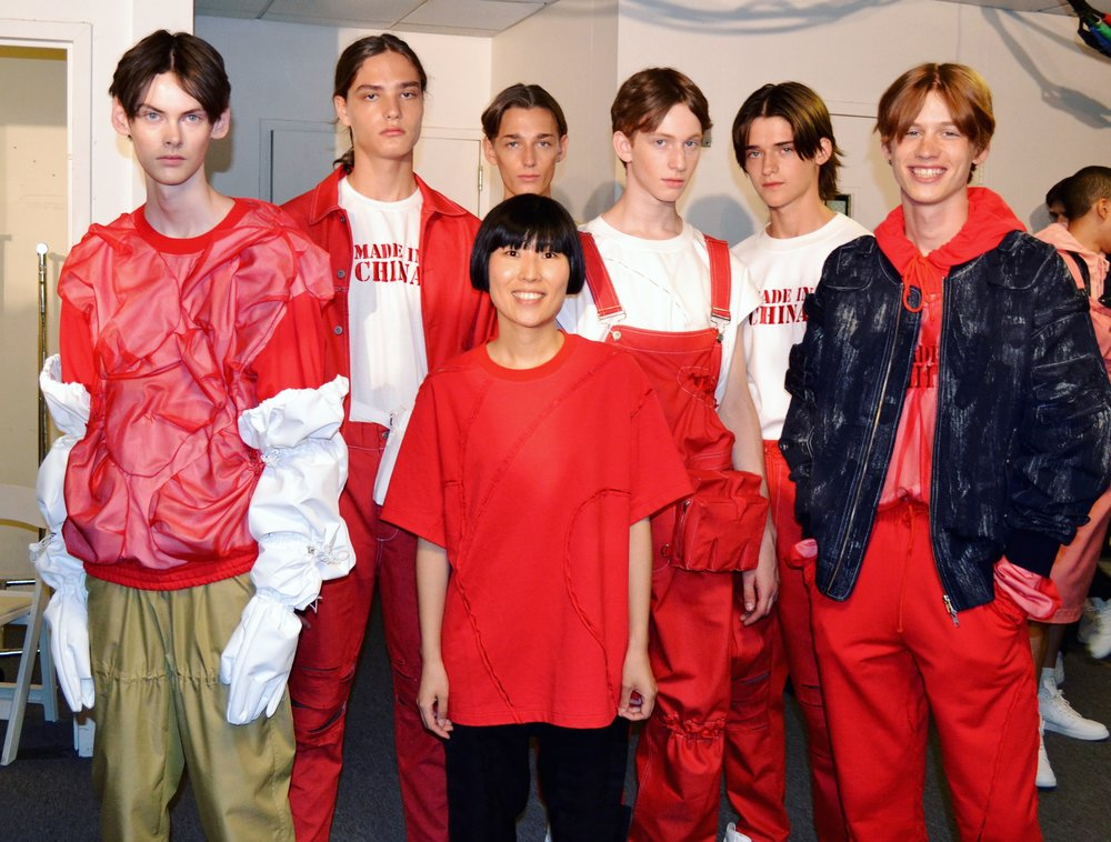 Designer Feng Chen Wang backstage with models.