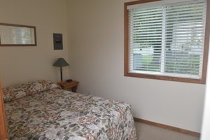 Lucky Horseshoe Cabin #21 - Interior 1st Bedroom with Full Bed.JPG