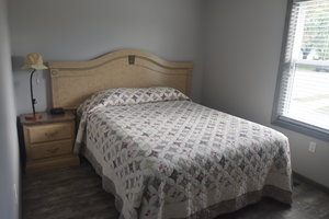 Lucky Horseshoe Cottage #17 - Interior 1st Bedroom with Queen Bed.JPG
