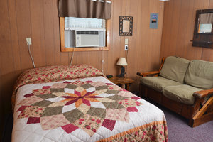 Lucky Horseshoe Room #27 - Interior (1) Full Size Bed and Seating.JPG