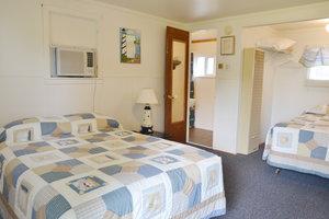 Lucky Horseshoe Room #26 - Interior 1st Full Size Bed.JPG
