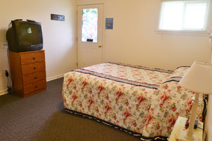 Lucky Horseshoe Room #23 - Interior Queen Bed and Entrance.JPG