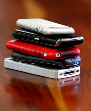 Phones stacked for a meeting. Photo Credit: Tuscon Local Media