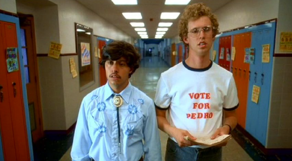 """Napoleon Dynamite"" (2012)  This movie is full of fantastic shirts. The ""Endurance"" running horse shirt and the ""Air Service International"" helicopter shirt, but none more recognizable than the one that made our list.  We have all seen it, and we know it instantly. The ""Vote For Pedro"" t-Shirt worn by actor Jon Heder."