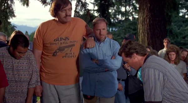 """Happy Gilmore"" (1996)  Mr. Larsons' (Richard Kiel) shirt in ""Happy Gilmore"" stuck with me over the years. I sometimes wish I had my own Mr. Larsons to help me out like he helped Adam Sandler in this film. Of course, he needs to be wearing the ""Guns don't kill people, I do"" t-shirt."