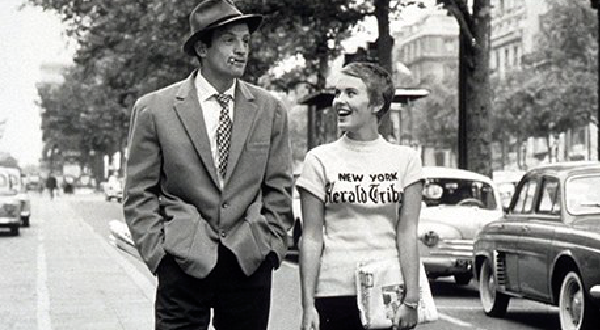 """Breathless"" (1960)  Jean Seberg plays Patricia Franchini, an american Journalist student, who wears this ""New York Herald Tribune"" t-shirt. This shirt started the craze to wear shirts to represent your city."