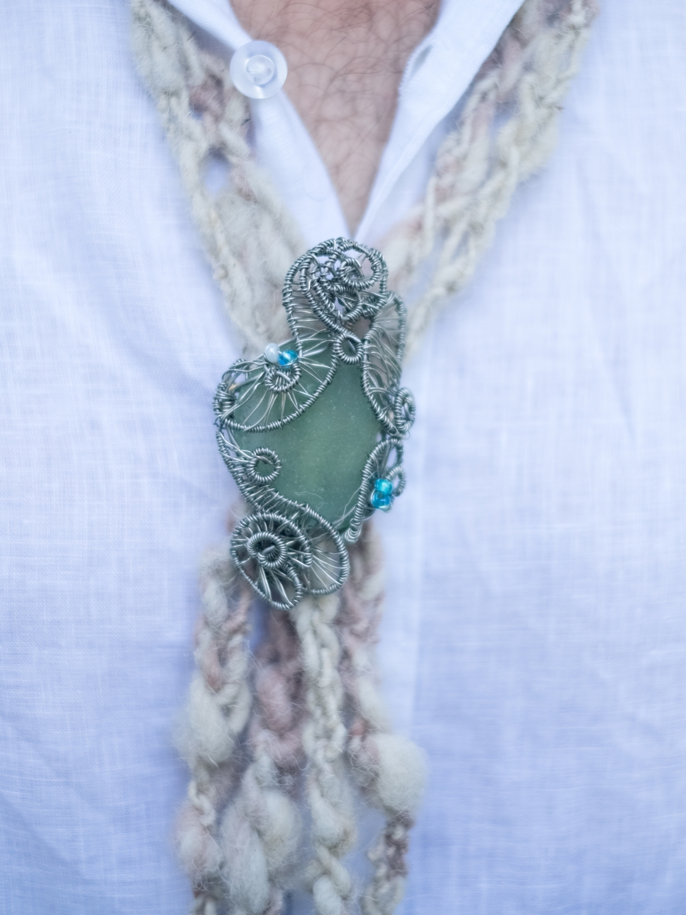 Sean's bolero tie, wool with sea glass clasp made by his mother.