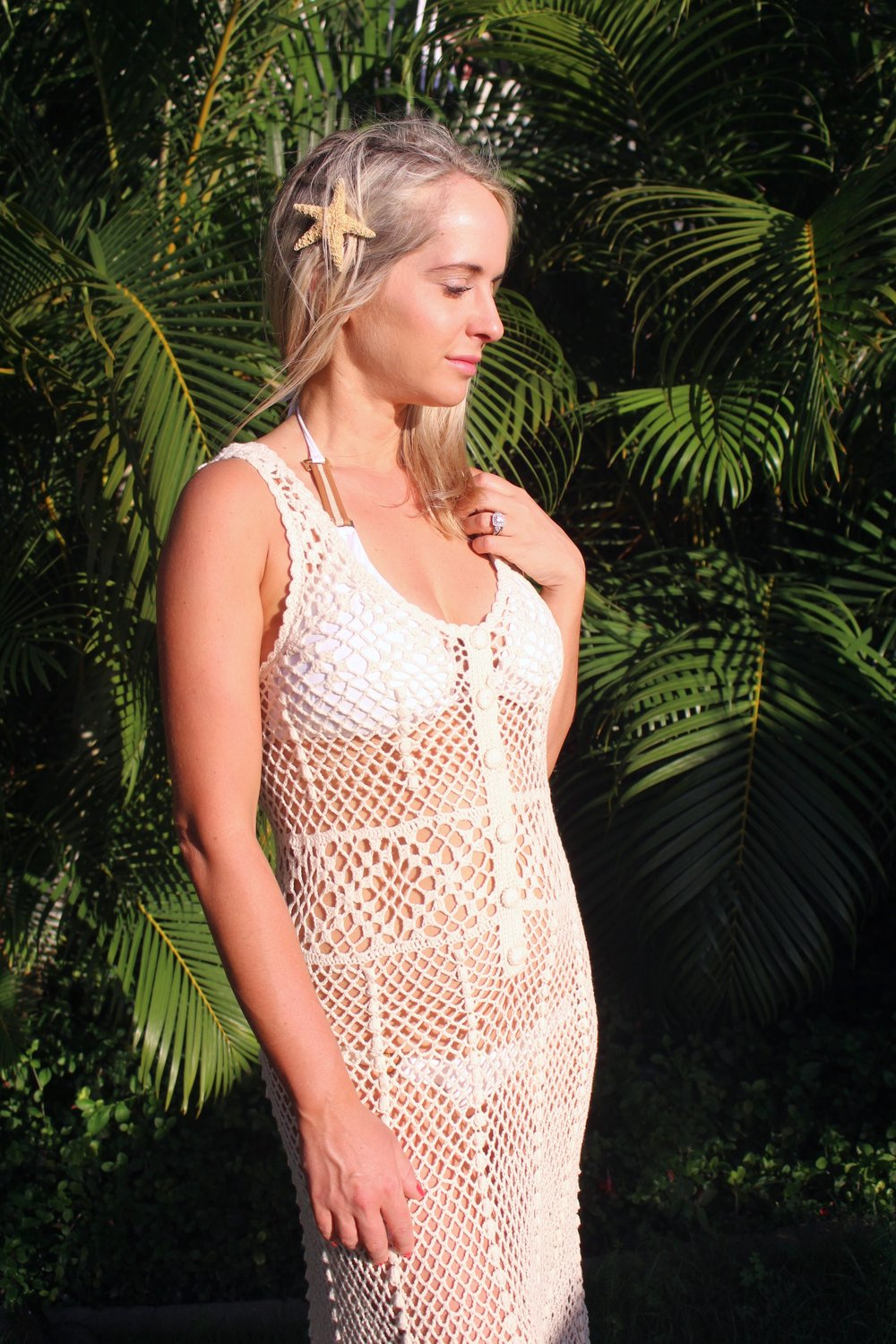 Cream crochet cover-up,  Urban Outfitters . White bikini with leather hardware, Vix Swimwear- similar  here . Starfish clip, similar  here .
