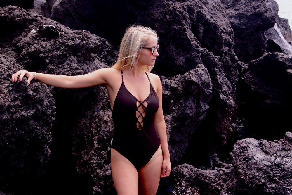 Black one piece swimsuit, Urban Outfitters. Similar here.