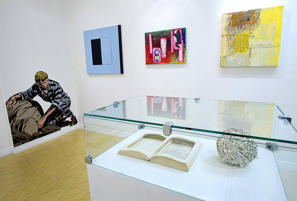 Artwork by Jerry Kearns, far left, and Ann Hamilton, foreground right, is displayed at the Satellite Contemporary gallery in the Emergency Arts building in downtown Las Vegas Tuesday, Feb. 24, 2015. Artwork on the back wall is by, from left, Peter Adsett, Morgan Blackgoat, and Jeanette Cole. Photo: Steve Marcus