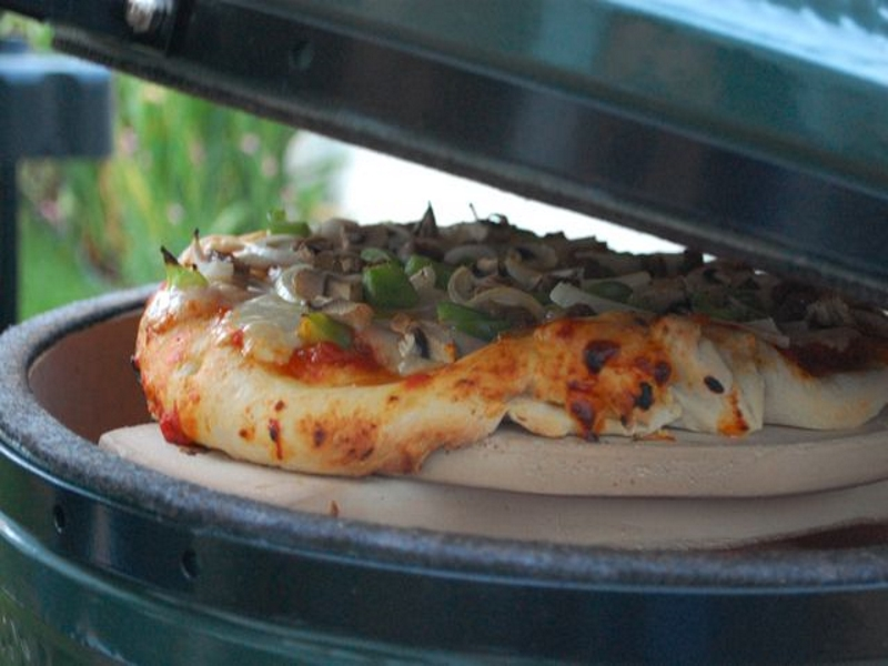 godbyhearthandhome bge big green egg cooking pizza stone