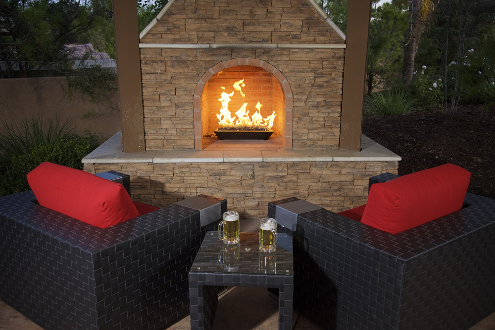 godby hearth and home glass burning fire outdoors two beers