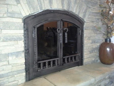 Fireplace doors can be constructed of steel or aluminum with a wide variety  of design features. Both metals come in a number of plated and powder coat  finish colors.