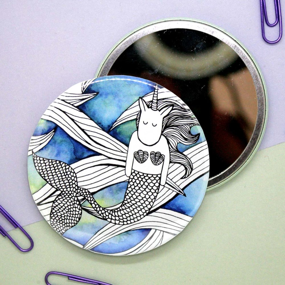 Round pocket mirror with illustration of mermicorn on a watercolour background