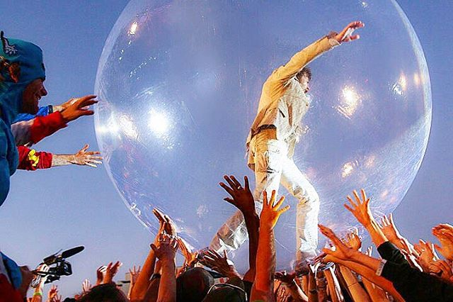 That time #waynemichaelcoyne of @oczymlody #flaminglips decided to walk on the crowd in a bubble at #voodoo2009 🎉🌈📷 . . . #concertphotography #livemusic #performanceart #neworleans #concertphotographer #musiclover #halloweencostumes #crowdwalking #itsathing